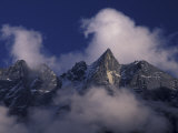 Clouds Swirl Around Mera Mountain, Nepal Photographic Print by John & Lisa Merrill