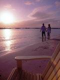 Couple Walking Along Beach at Sunset, Nassau, Bahamas, Caribbean Photographic Print by Greg Johnston