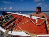 Fisherman Tends His Boat on the Beach, Isla Margarita, Venezuela Photographic Print by Greg Johnston