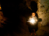 A Palestinian Boy Holds a Sparkler after Breaking the Fast on the First Day of Ramadan in Gaza City Photographic Print