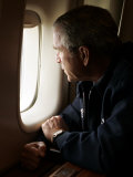 President Bush Looks out the Window of Air Force One Over New Orleans Photographic Print