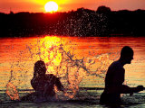 An Unidentified Couple Splashes in Lake Wandlitz Near Berlin on a Warm Evening Photographic Print