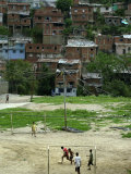 Venezuelan Children Play Soccer at the Resplandor Shantytown Photographie