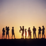 Large Family Silhouetted by Sunset Photographic Print