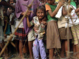An East Timorese Child Cries Photographic Print