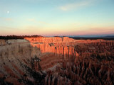 Bryce Canyon, as the First Light of Dawn Illuminates the Rugged Terrain Photographic Print