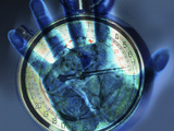Abstract View of a Blue Hand over a Stop Watch Photographic Print