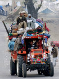 A Pakistan Earthquake Survivor Family Ride a Vehicle as They Make Their Way to Mansehra Photographic Print