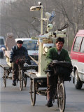 Two Delivery Riders Carry a Dentists Drill and Chair Along a Beijing Street January 4 Photographic Print