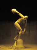 Nude Man Painted Gold Posing As a Statue Photographic Print by Jim McGuire
