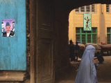 An Afghan Woman Wearing Burqa Walks Under a Bridge with Posters of Afghan President Hamid Karzai Photographic Print