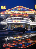 A Karaoke Bar on Dongsanhuan Road is Reflected in a Vehicles Trunk Photographic Print by Richard Nowitz