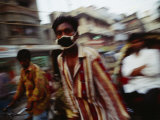 A Rickshaw Driver Wears a Mask to Keep Pollution Out of His Lungs in Dhaka Photographic Print