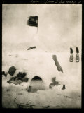 Commander Pearys Igloo is Marked by an American Flag on Top and Surrounded by Scattered Supplies Photographic Print by Robert Peary