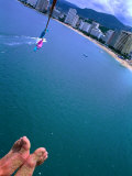 Sandy Feet of Parasailer and High Angle View of City, Acapulco, Mexico Photographic Print by Philip Smith