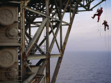 Remote Access Technicians Dangle off Ropes on an Oil Rig Photographic Print by Justin Guariglia