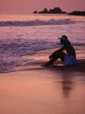 Woman Sitting on Beach at Sunset in Ixtapa, Near Zihuatanejo, Zihuatanejo, Mexico Photographic Print by Philip Smith