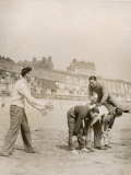 Five Men Playing Leap Frog on the Sandy Beach at Ramsgate Photographic Print