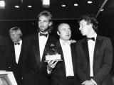 Phil Collins with Mike Rutherford and Tony Banks at the Mirror's British Video Awards Fotografisk tryk
