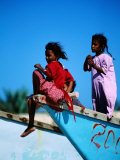 Young Girls on Dhow Fishing Boat Near Qalansia Village, Yemen Photographic Print by Frances Linzee Gordon
