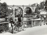 Two Cyclists Take a Break on a Bridge Over the River Nidd at Knaresborough Photographic Print by Fred Musto