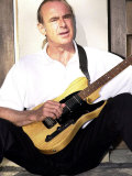 Status Quo's Francis Rossi Practise's with One of His Favourite Guitar's at His Home in Surrey Fotografisk tryk