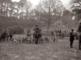 Hunting Men Riding Horses with a Pack of Hounds Photographie