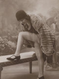 Young Woman Wearing a Fur Coat Cloche Hat and T-Bar Shoes Lifts Her Leg Up Photographic Print