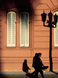 Pedestrian and Shadows Outside Casa Rosada, Plaza De Mayo, Buenos Aires, Argentina Photographic Print by Michael Taylor