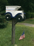 United States Flag and a Mailbox Designed to Look Like a Mail Truck Photographic Print by Darlyne A. Murawski