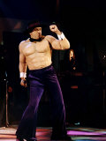 Peter Gabriel Wearing Latex Rubber False Muscle Bound Body and Purple Flared Trousers Fotografická reprodukce