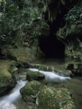 Water Flows from the Mouth of the Tunichil Muknal Cave Photographic Print