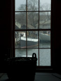 Looking Out Through a Window at Wooden Fishing Boats on a River Photographic Print by Todd Gipstein