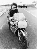 David Essex on the Set of His Film Silver Dream Racer Sitting on a Racing Motorbike, January 1980 Fotodruck