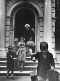 Young Children Carrying Their Own Suitcases and Belongings Down Steps Photographic Print