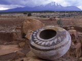 An Ancient Pottery Seed Jar, with Sleeping Ute Mountain in the Distance Photographic Print by Ira Block