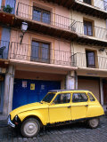 Yellow Citroen Parked Outside Apartments, Calatayud, Spain Photographic Print by John Banagan