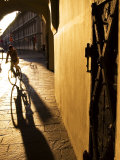 Early Morning Cyclist in Innsbruck's Altstadt (Old Town), Innsbruck, Austria Photographic Print by Glenn Beanland
