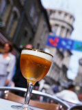 Glass of Beer at Cafe with Cathedral in Background, Boulogne-Sur-Mer, France Photographic Print by John Banagan
