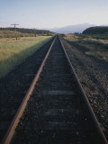 A Train Track in Colorado at Sunset Photographic Print by Taylor S. Kennedy