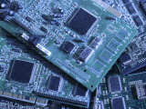 Computer Boards and Chips Lie in a Pile Photographic Print by Taylor S. Kennedy