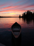 Canoe Floating in Lake During Sunset Photographic Print by Keith Levit