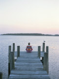 A Seagull Watches a Woman Practice Yoga on a Dock Photographic Print by Taylor S. Kennedy