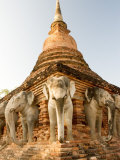 Elephant Statues at the Base of Wat Cahang Lom, Thailand Photographic Print by Gavriel Jecan