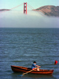 An Unidentified Man Rows His Boat by the Golden Gate Bridge Photographic Print