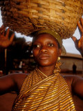 Woman Wearing Gold Fabric Dress and Carrying Basket, Kabile, Brong-Ahafo Region, Ghana Photographic Print by Alison Jones