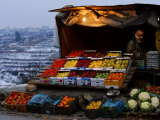 A Palestinian Fruit and Vegetable Vendor Waits for Customers Photographic Print by Kevin Frayer