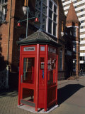 A Red Phone Booth and Victorian Architecture Photographic Print by Rich Reid