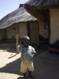 Child by Straw Hut, South Africa Photographic Print by Ryan Ross
