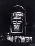 The Strand Theatre, London is Lit up at Night to Advertise the Play Maigret Starring Rupert Davies Photographic Print